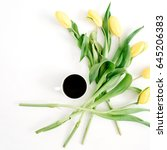 cup of coffee and yellow tulip... | Shutterstock . vector #645206383