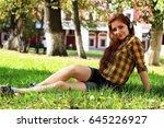 red haired girl in park sunny... | Shutterstock . vector #645226927