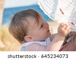 young beautiful mother and her... | Shutterstock . vector #645234073