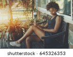 cute brazilian lady is sitting... | Shutterstock . vector #645326353