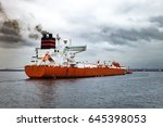tug boat towing a tanker ship... | Shutterstock . vector #645398053