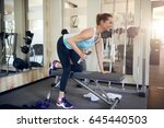 middle aged woman working out... | Shutterstock . vector #645440503