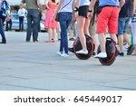 between many walkers one couple ... | Shutterstock . vector #645449017
