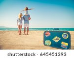 happy family on the beach.... | Shutterstock . vector #645451393