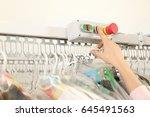 Female Laundry Worker Pushing...