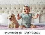 little baby girl sit on the bed ... | Shutterstock . vector #645496537