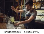 young male bartender preparing... | Shutterstock . vector #645581947