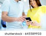 happy couple buying new smart...   Shutterstock . vector #645589933