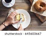 woman hand spreading butter on... | Shutterstock . vector #645603667