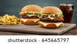 two craft beef burgers on... | Shutterstock . vector #645665797