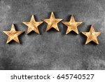 five stars on dark background   Shutterstock . vector #645740527