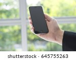 businessman holding device  ... | Shutterstock . vector #645755263
