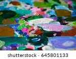 Small photo of Abstract artist oil paints on the palette as a background/texture