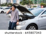 young asian man has broken down ... | Shutterstock . vector #645807343