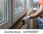 worker is installing a window... | Shutterstock . vector #645900007