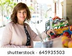 attractive middle aged woman... | Shutterstock . vector #645935503