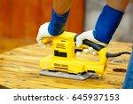 close up of a man using an... | Shutterstock . vector #645937153