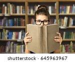 student read open book  eyes in ... | Shutterstock . vector #645963967