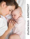 mother with newborn baby... | Shutterstock . vector #646050637