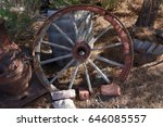 weathered wheel in the desert | Shutterstock . vector #646085557