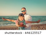 happy family on the beach.... | Shutterstock . vector #646125517