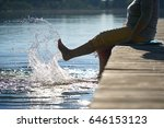 happy mature woman at a lake... | Shutterstock . vector #646153123