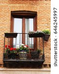 spanish facade with balcony | Shutterstock . vector #646245997