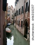 Small photo of Venice canal with boat, Italy
