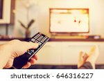 the man with the remote control ... | Shutterstock . vector #646316227