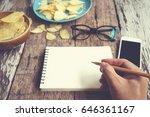 hand using smartphone on wooden ...   Shutterstock . vector #646361167