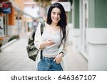 asia woman walking and using a... | Shutterstock . vector #646367107