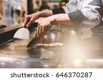hand of man take cooking of... | Shutterstock . vector #646370287