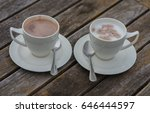 cups of coffee on a wooden... | Shutterstock . vector #646444597