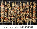 skewers on barbecue grill | Shutterstock . vector #646558687