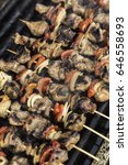 skewers on barbecue grill | Shutterstock . vector #646558693