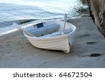 Small Rowboat Anchored At Shor...