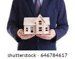 man holding house model on... | Shutterstock . vector #646784617