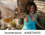 Small photo of Unconscious drunken man having beer in the park