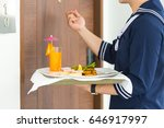 waiter holding plate with... | Shutterstock . vector #646917997