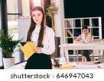 confident businesswoman using