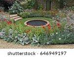 colourful walled cottage garden ... | Shutterstock . vector #646949197