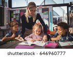 teacher helping schoolgirl with ... | Shutterstock . vector #646960777