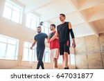 portrait of three basketball... | Shutterstock . vector #647031877