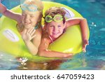 kid in swimming pool. | Shutterstock . vector #647059423