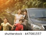 happy children running from car  | Shutterstock . vector #647081557