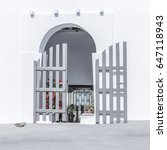 Small photo of Island Village Door . Arched Doric Entrance. Typical Greek Architecture of the Aegean Islands.