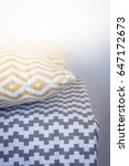 yellow pillow and gray plaid | Shutterstock . vector #647172673