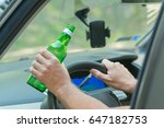 man holding green bottle of... | Shutterstock . vector #647182753