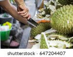 a man with knife is peeling the ... | Shutterstock . vector #647204407