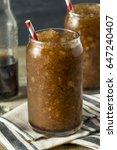 Small photo of Frozen Homemade Soda Pop Slushy Drink with a Straw